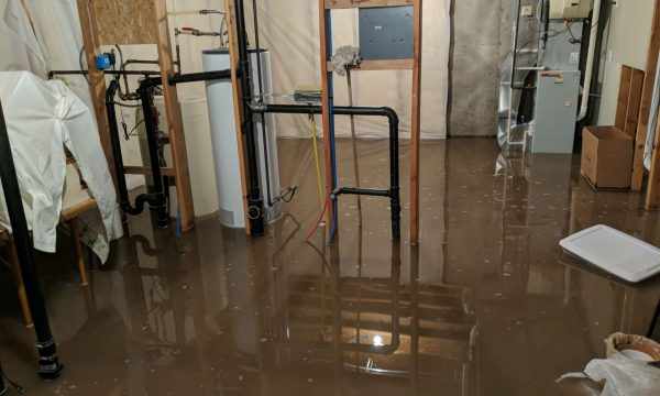 basement flood requiring emergency restoration services